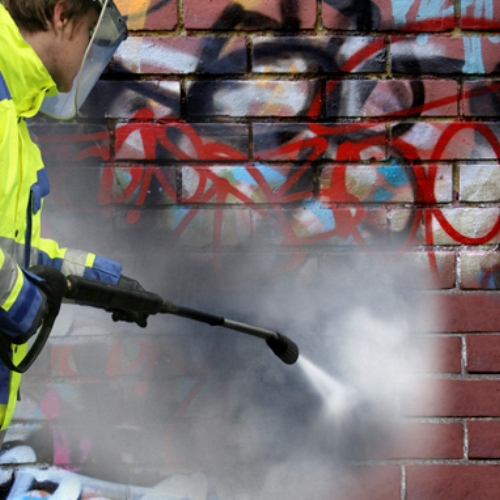 Graffiti Removal Contractor Cleaning Graffiti from Brick
